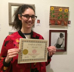 Abby Gates receives a Certificate for her acyrlic painting, Pastines for a Lifetime Student Art Showcase