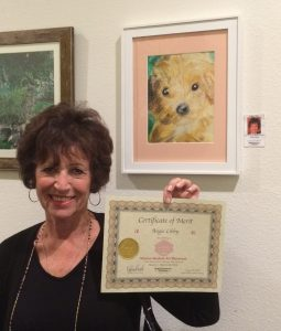 Angela Libby receives a Certificate for her oil pastel, Pastimes for a Lifetime Student Art Showcase