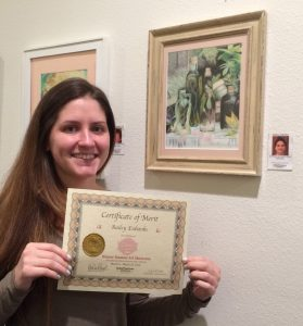 Bailey Eubanks receives a Certificate for her oil pastel work, Pastimes for a Lifetime Student Art Showcase