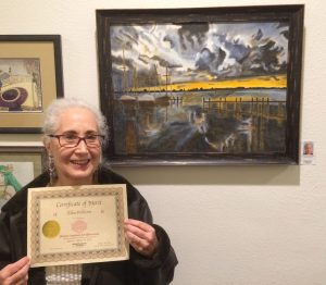 Ellen Wilheim receives a Certificate for her oil painting, Pastimes for a Lifetime, Student Art Showcase