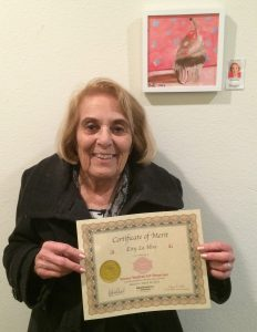 Esty La Hive receives a Certificate for her oil painting, Pastimes for a Lifetime Student Art Showcase