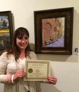 Gina Murphy receives a Certificate for her acrylic painting, Pastimes for a Lifetime Student Art Showcase