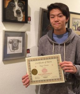 Hugo Tomita receives Certificate for his Graphite work, Pastimes for a Lifetime Student Art Showcase
