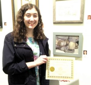 Shayna Sternin receives a Certiicate for her acrylic painting, Pastimes for a Lifetime Student Art Showcase