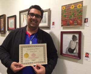 Sumeet Vazir receives a Certificate for his acrylic fashion study, Pastimes for a Lifetime Student Art Showcase