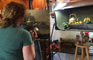 Regina Lyubovnaya adds fruit to the painting