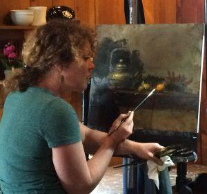 Regina Lyubovnaya adding fruit to the painting