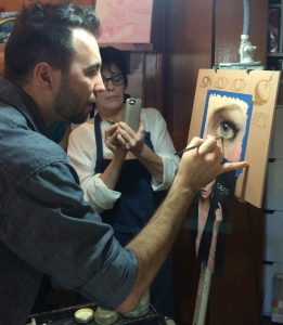 Ignat Ignatov adds the final touches to the eye painting
