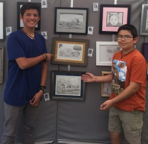 Students receive Certificates of Merit at Pastimes for a LIfetime's Student Art Showcase