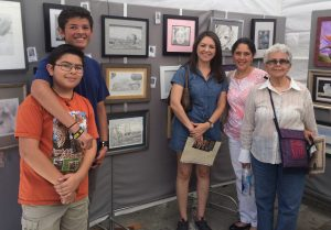 Families meet at Pastimes for a Lifetime's Booth at the Downtown Burbank Arts Festival