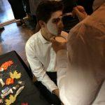 Sophia paints Aidan as the Phantom of the Opera