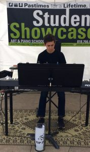 Pastimes for a Lifetime piano student Aidan C performs at the Downtown Burbank Arts Festival