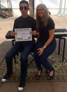 Pastimes for a Lifetime piano student, Chris K. receives a Certificate of Merit for performing at the Downtown Burbank Arts Festival