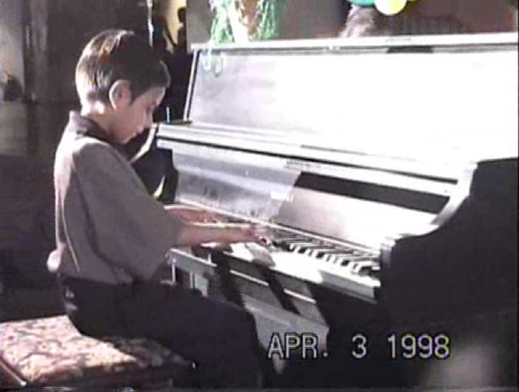 Vijay Venkatesh at the piano as a child