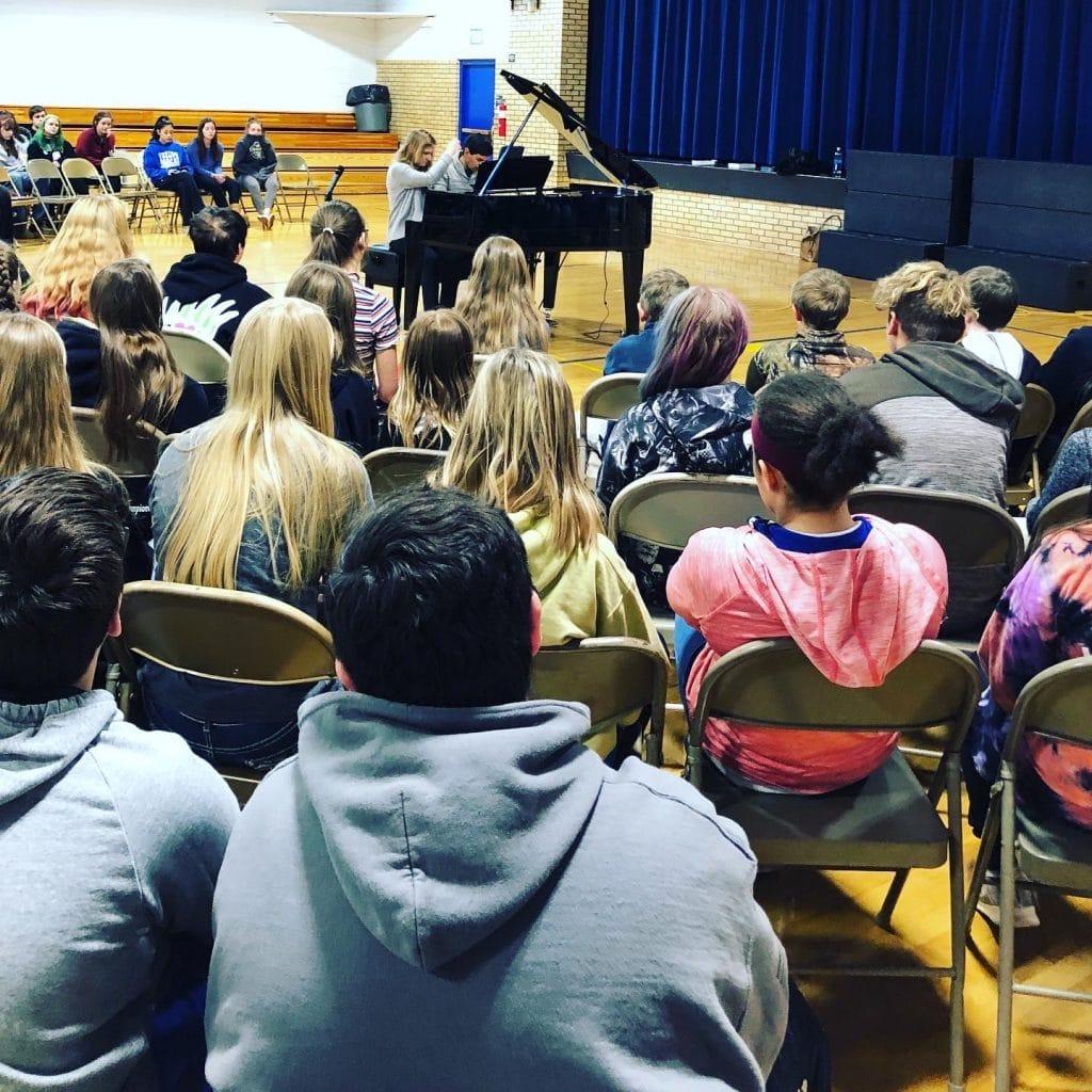 The Vieness due performing outreach at school in Colorado