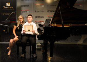 Michael G. with piano teacher Linda Wehrli