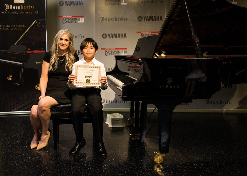 Ryan B. with piano teacher Linda Wehrli