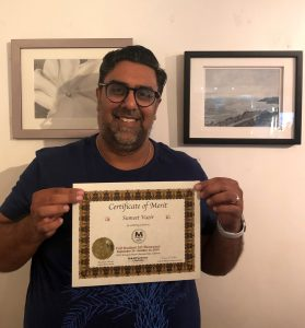 Pastimes for a Lifetime art student Sumeet V. receives a Certificate of Merit at the 2019 Fall Student Art Showcase.