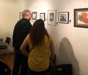 Guests enjoy viewing Pastimes for a Lifetime's 2019 Fall Student Art Showcase at the M Street Coffee.