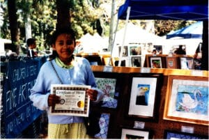 Krystal Hill with her Art Show Certificate of Merit 1999