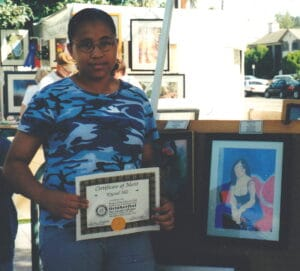 Krystal Hill with her Art Show Certificate 2001