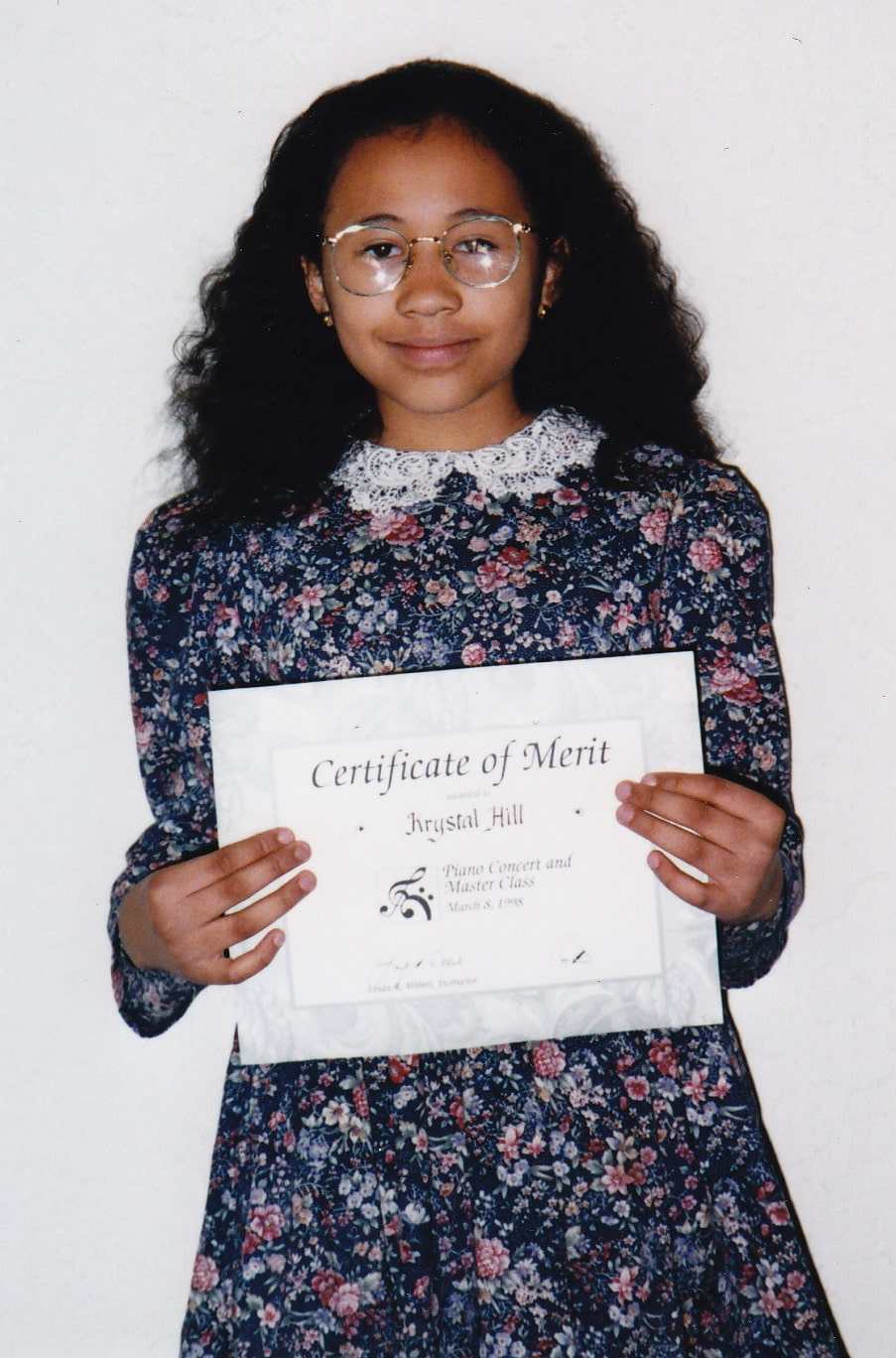 Krystal Hill with her Piano Certificate of Merit
