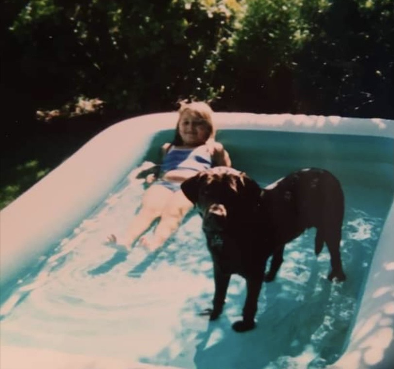 Taylor McLeod as a girl with her dog, Coby.