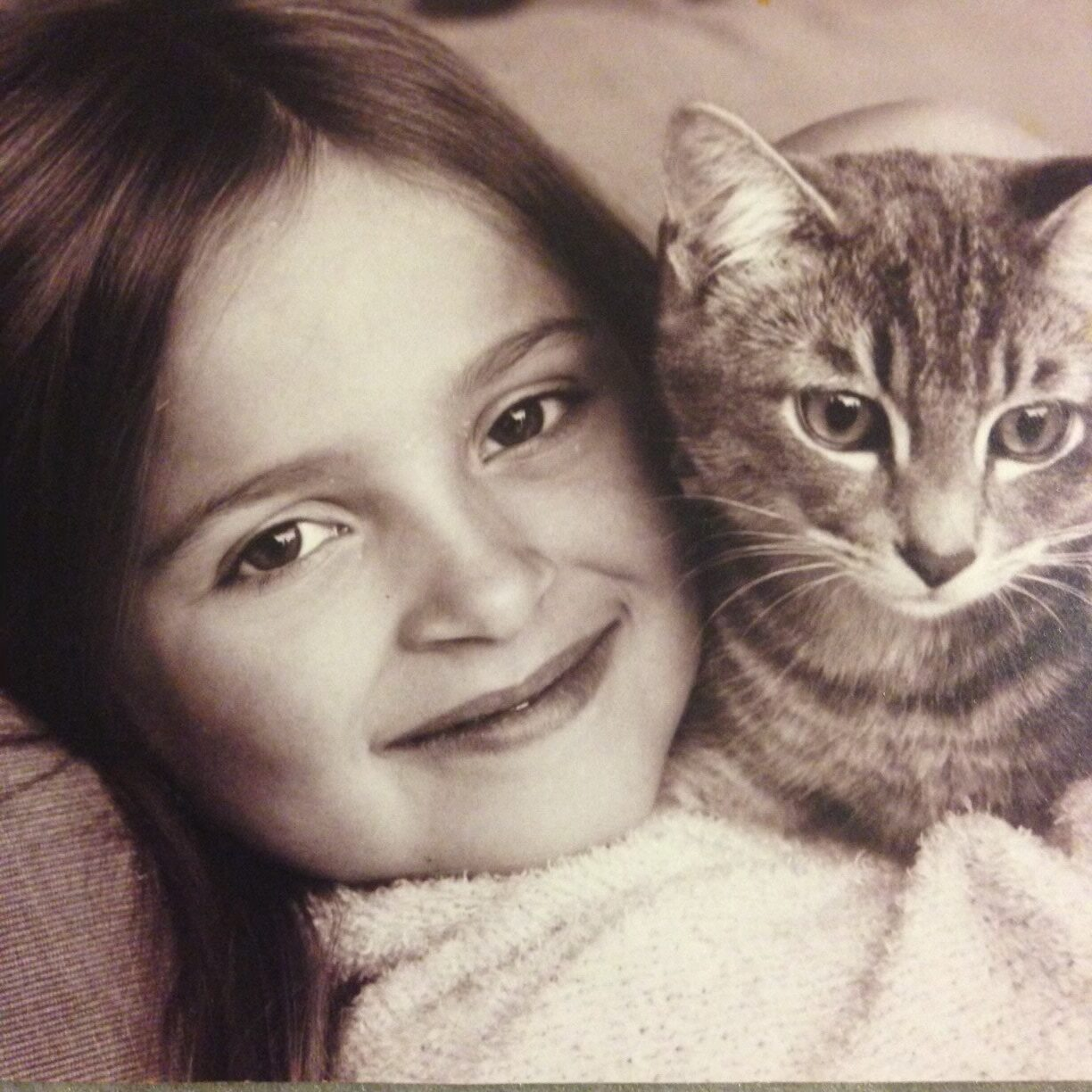 Taylor McLeod as a girl with her cat, Stormy