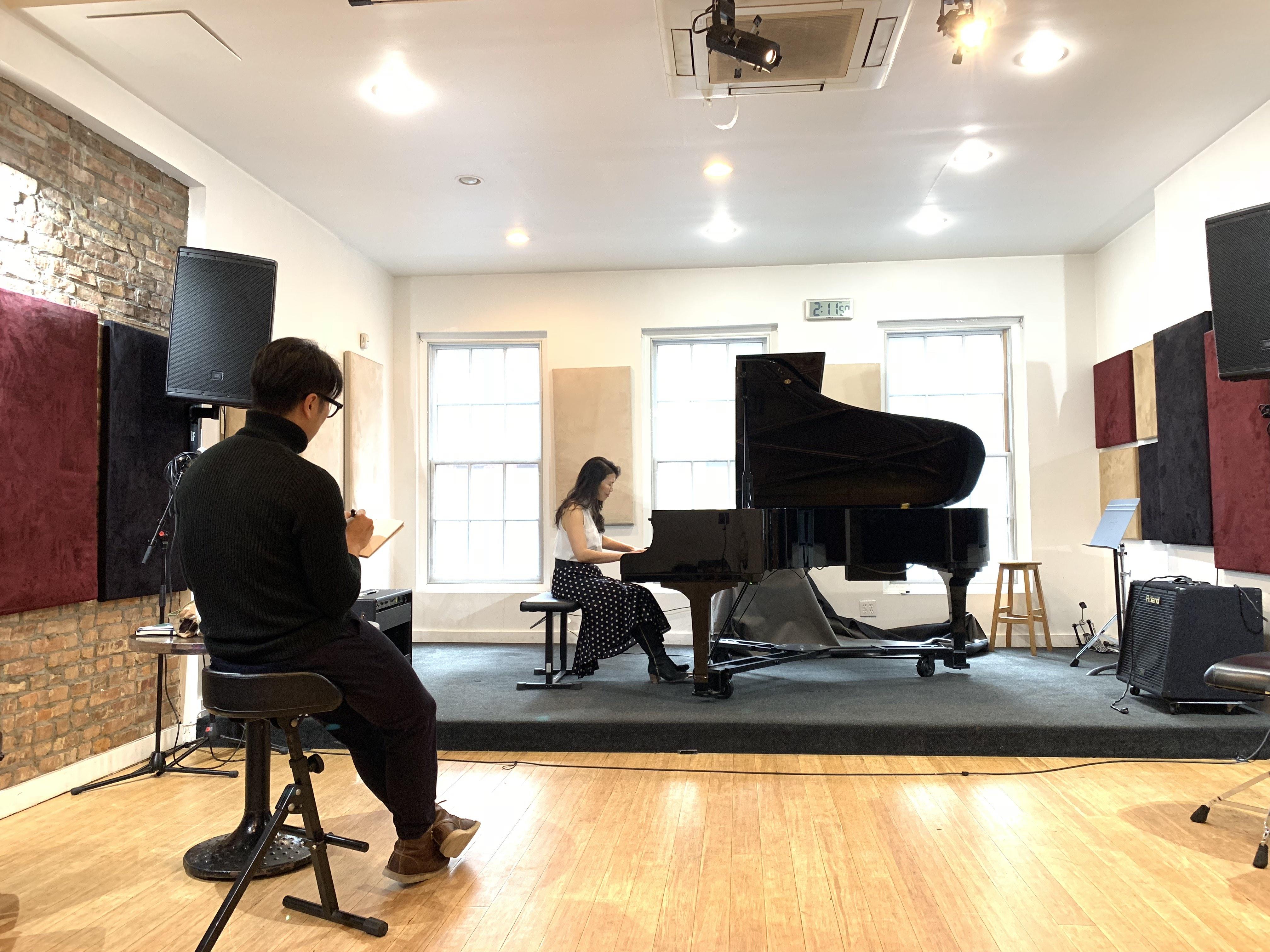 Moonsub Shin sketches to Jeeyoon Kim's piano solos.