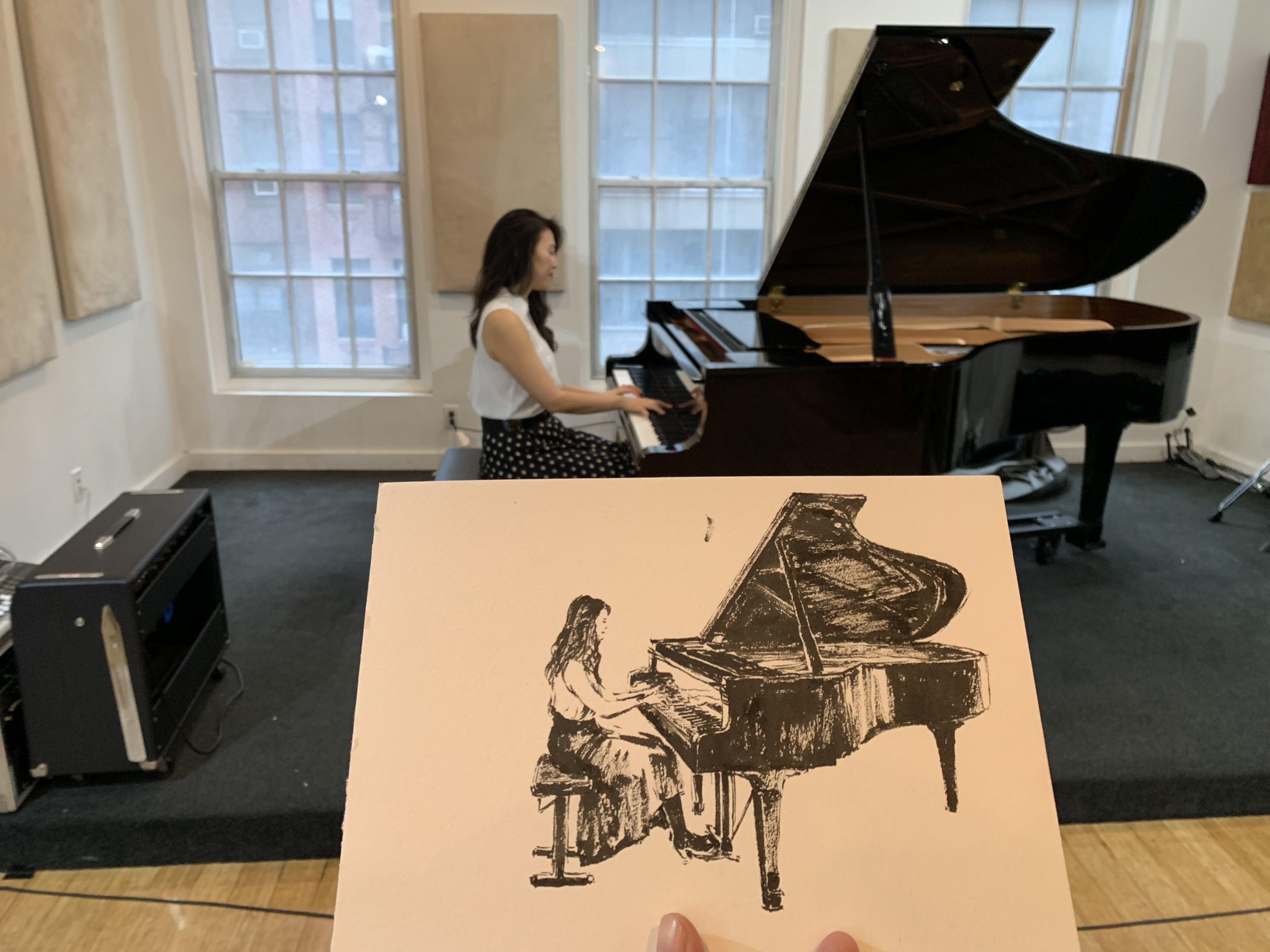 Moonsub Shin illustrates to Jeeyon Kim's piano solos.