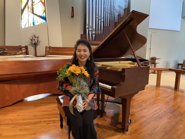 First Fridays at First Jeeyoon Kim receives a bouquet after her performance videotaping.